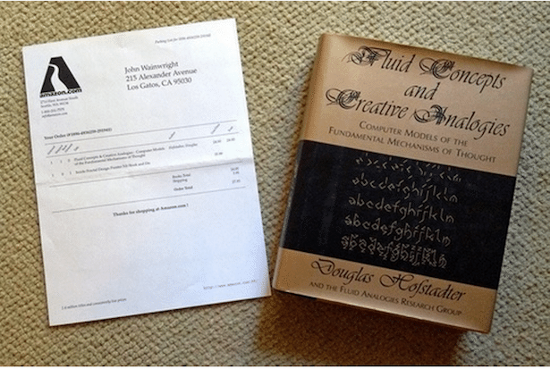 Photo showing the book and packing slip included with Amazon's first order in 1995.